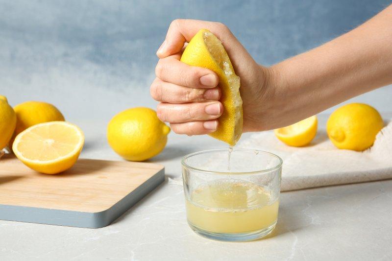 Hand juicing lemons