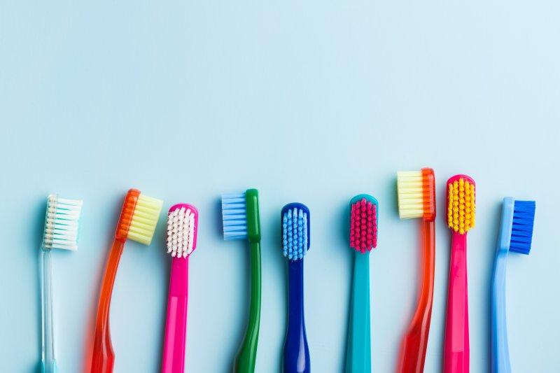 row of colorful toothbrushes