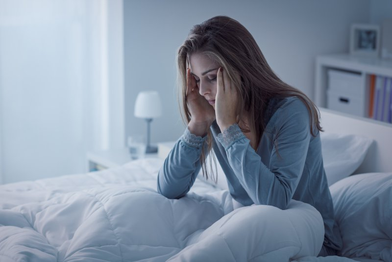 Woman awake with toothache